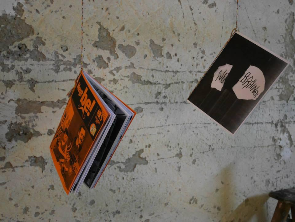 Two publications haning on strings at a wall