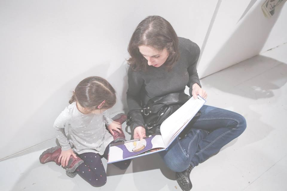 Mother and child looking at a book together