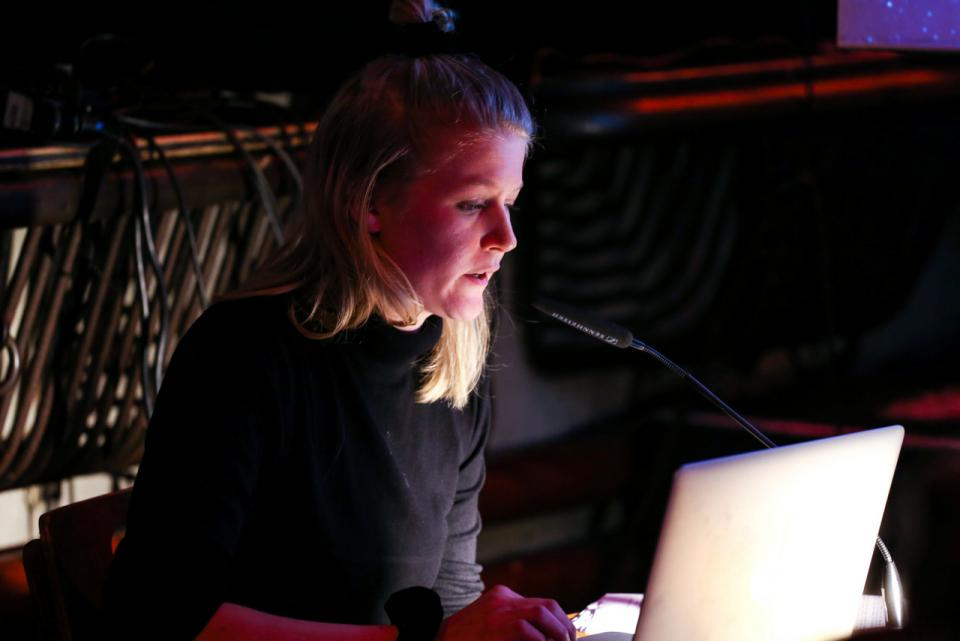Girl and her laptop during a performance